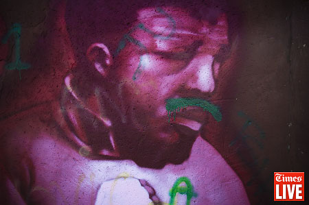 A vandalised portrait of Nelson Mandela is spraypainted on a wall in Aukland Park, Johannesburg. June 2012