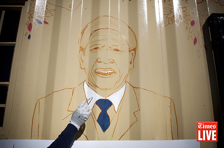 A portrait of Nelson Mandela is painted on the side of a new library at the Tsakane Primary School in Johannesburg, South Africa. July 2011