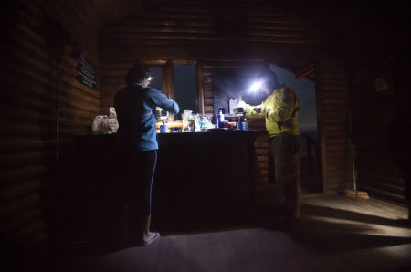 Hikers prepare dinner at the Oakhurst hut. Dec 2012