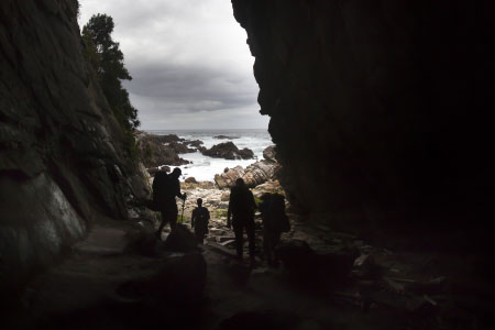 Hikers explore a cave. Nov 2012
