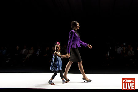 A young model walks down the catwalk during the Khosi Nkosi fashion show. March 2013