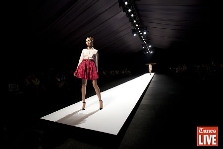 A model walks down the catwalk during the Grapevine fashion show. March 2013