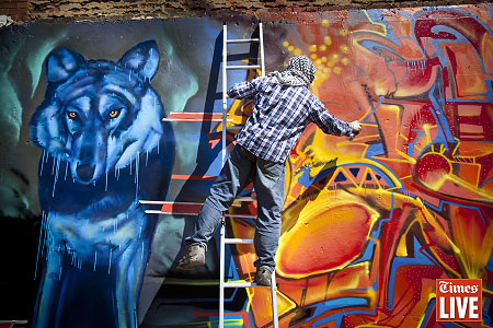 Graffiti artist Boyd Hill, from Brixton in London, spray paints a wall in Newtown, Johannesburg. His piece showing the wolf as the South African Police Service and the potential chaos it can create. Hill who lived in Cape Town 11 years ago, was outraged by the stories of police brutality in recent news and decided to paint the piece after he was invited to the country as part of the 'Back to the City' festival to be held on 27 April. Apr 2013