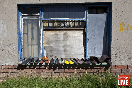 Shoes are aired outside a home in Kliptown, Soweto. Apr 2013