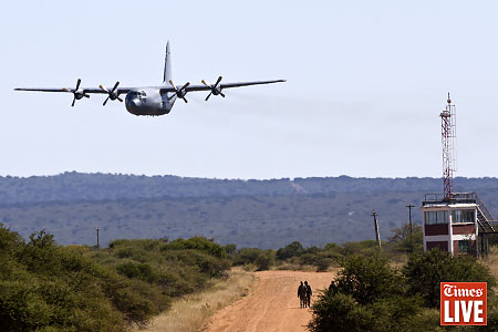 A South African Air Force C130 flies during an air force capability demonstration at the Roodewal Bombing Range. May 2013