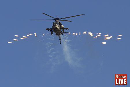 A South African Air Force Rooivalk helicopter releases flares. May 2013