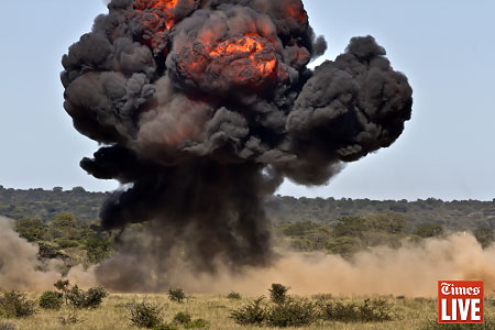 An explosion is seen during an air force capability demonstration at the Roodewal Bombing Range. May 2013