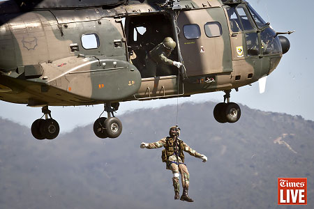 A SANDF soldier is hoisted up a rope from a South African Air Force Oryx helicopter. May 2013