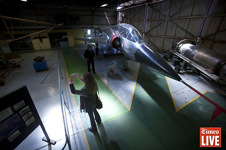 A person takes a photograph inside a hangar at the South African Airforce Museum at the Swartkops Airfield in Centurion. The 2013 SAAF Museum Air Show will take place on 11 May 2013. The airshow has been given the theme '40 years of aviation', as 2013 marks the 40th anniversary of the SA Airforce Museum. May 2013